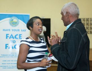 Resident Michael Keens-Dumas chats with Secretary of Tourism, Culture and Transportation Nadine Stewart following the community meeting.