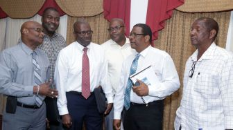 From left, Airports Authority Deputy General Manager (Tobago) Lincoln Charles, Area Representative Clarence Jacob, Chief Administrator Raye Sandy, Airports Authority General Manager Hayden Newton, THA legal counsel Alvin Pascall and THA's representative on the Airports Authority board Joseph Granville.