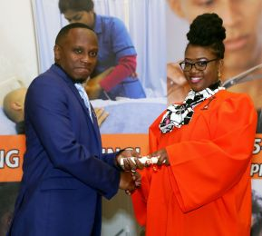 YTEPP Deputy Chairman Jesse Moss presents Shanicia Debidin with her graduation certificate.
