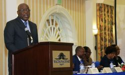 Chief Secretary Kelvin Charles addresses the audience.