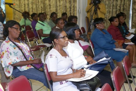 Members of the audience listen attentively.