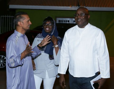 Chief Secretary Kelvin Charles and wife Catherine Anthony-Charles are greeted by Kameal Ali, coordinator and administrator at the mosque.