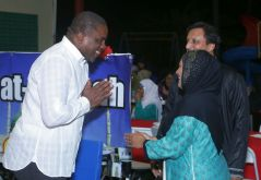 Secretary of Finance and the Economy Joel Jack greets hosts of the event Arifa Bansal and her husband Munish Bansal.