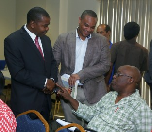 JSC member Foster Cummings, left, Secretary of Infrastructure, Quarries and the Environment Kwesi Des Vignes and Chief Secretary Kelvin Charles.