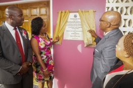 Secretary of Community Development Enterprise Development and Labour Marslyn Melville-Jack and THA Chief Secretary Kelvin Charles, right, unveil the plaque commemorating the recommissioning of the Castara Community Centre. At left is Assistant Secretary of Community Development, Enterprise Development and Labour, Shomari Hector.