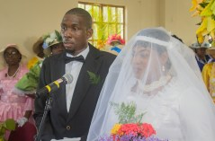The bride and groom during their ceremony at the Mt Moriah Moravian Church.