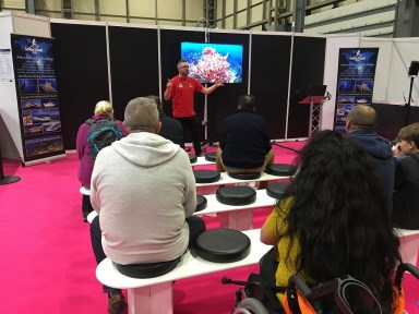 """Swiss Robinson makes a presentation on """"Diving in Tobago"""" at the Birmingham Dive Show."""
