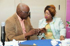 Chief Secretary Kelvin Charles talks with Carolann Birchwood-James.