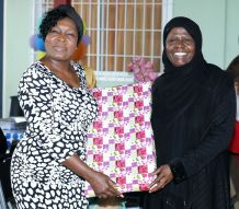 Shilah Peters presents a gift to Secretary of the Division of Community Development, Enterprise Development, and Labour Marslyn Melville-Jack.