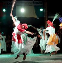 Dancers move to the rhythm as they perform in unison.