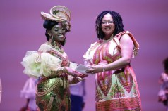 2nd runner-up, Shanice John from the Goodwood Police Youth Club, receives an award from First Citizens' Assistant Manager (Canaan Branch) Arlene St Louis-Brathwaite.