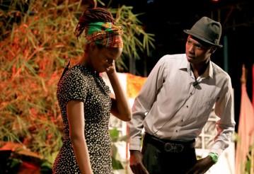 Enus (Keshawn Mills) and his best friend Betsy (Roanne Augustine) chat.