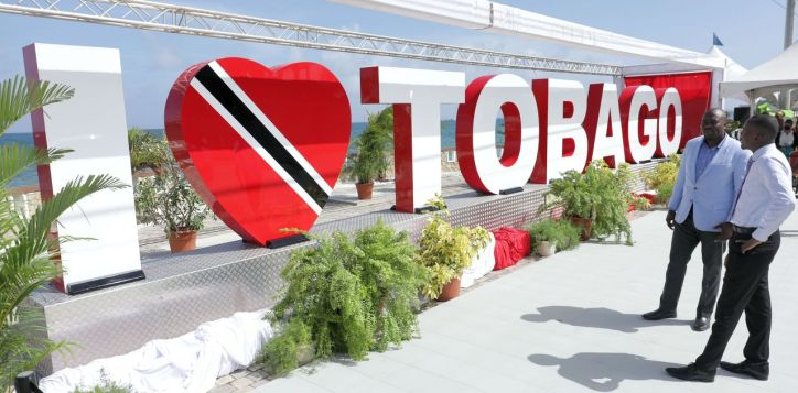 THA Chief Secretary Hon. Ancil Dennis and Secretary of Settlements, Urban Renewal and Public Utilities Clarence Jacob observe the new 'I Love Tobago' sign.