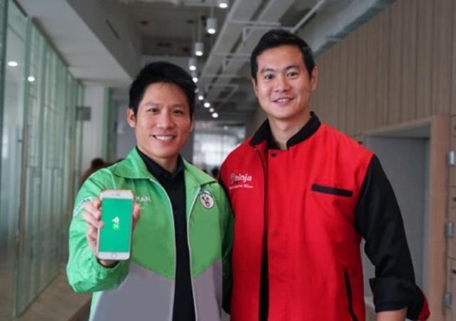 (ซ้าย) ธารวิทย์ ดิษยวงศ์ ผู้จัดการบริการ LINE MAN (ส่งพัสดุ), LINE ประเทศไทย (ขวา)  วีรชัย ชูสกุลพร กรรมการผู้จัดการ บริษัท นินจา แวน จำกัด