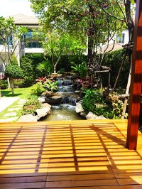 Tropical Rock Waterfall, Pond and Shaded Deck in Bangkok ...
