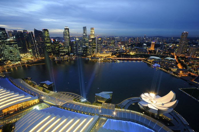 Marina Bay and the skyline of the Central Business District of Singapore at dusk