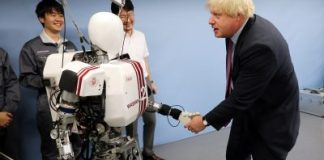 Boris Johnson shakes hands with a humanoid robot Wabian2 at Research Institute for Science and Engineering at Waseda University