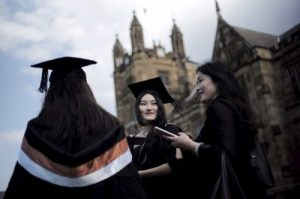 A university student wears her mortar hat following her graduation ceremony from the School of Commerce at the University of Sydney in Australia, 22 April, 2016 (Photo: Reuters/Reed).