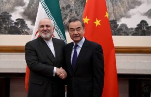 China's Foreign Minister Wang Yi shakes hands with Iran's Foreign Minister Mohammad Javad Zarif during a meeting at the Diaoyutai state guest house in Beijing, China, 31 December 2019 (Photo: Reuters/Noel Celis).