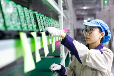 A worker inspects and arranges production for elevator signal system at a factory of Jiangsu WELM Technology Co., Ltd. in Hai'an city, east China's Jiangsu province, 24 August 2020 (Photo: Reuters).