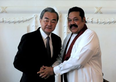 Chinese Foreign Minister Wang Yi shakes hands with Sri Lankan Prime Minister Mahinda Rajapaksa in Colombo, Sri Lanka, 14 January 2020 (Photo: Reuters/Dinuka Liyanawatte).