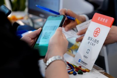 A sign indicating digital yuan, also referred to as e-CNY, is pictured at a shopping mall in Shanghai, China, 5 May 2021 (Reuters/Aly Song).