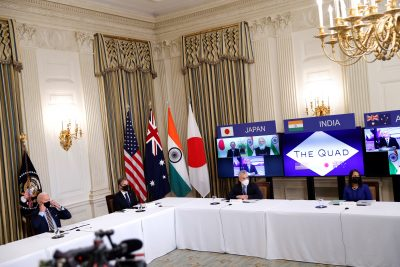 US President Joe Biden and Vice President Kamala Harris, not pictured, participate beside staff and cabinet members in a virtual meeting with Asia-Pacific nation leaders at the White House in Washington, 12 March 2021 (Photo: Reuters/Tom Brenner).