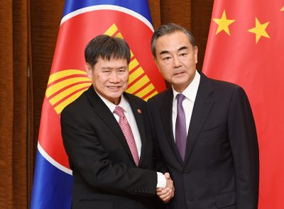 ASEAN Secretary-General, Lim Jock Hoi, is greeted by Chinese Foreign Minister, Wang Yi, before a meeting in Beijing, China, 12 June, 2018. (Photo: Greg Baker/Pool via Reuters)