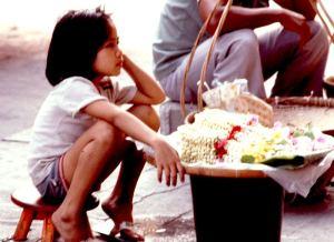 Girl selling flowers in Bangkok