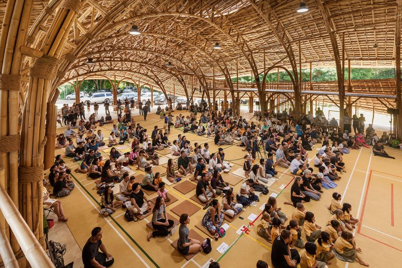 300 students inside the eco-friendly bamboo Sport Hall at Panyaden School, Chiang Mai
