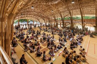 300 students inside the eco-friendly bamboo Sport Hall at Panyaden School, Chiang Mai