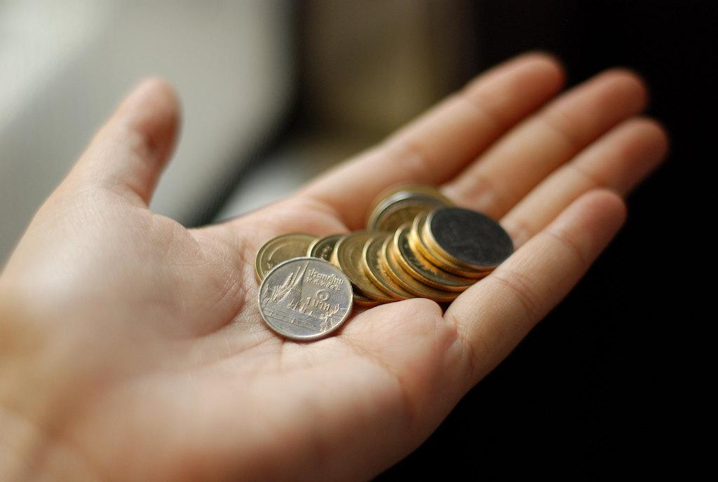 A handful of Thai baht coins