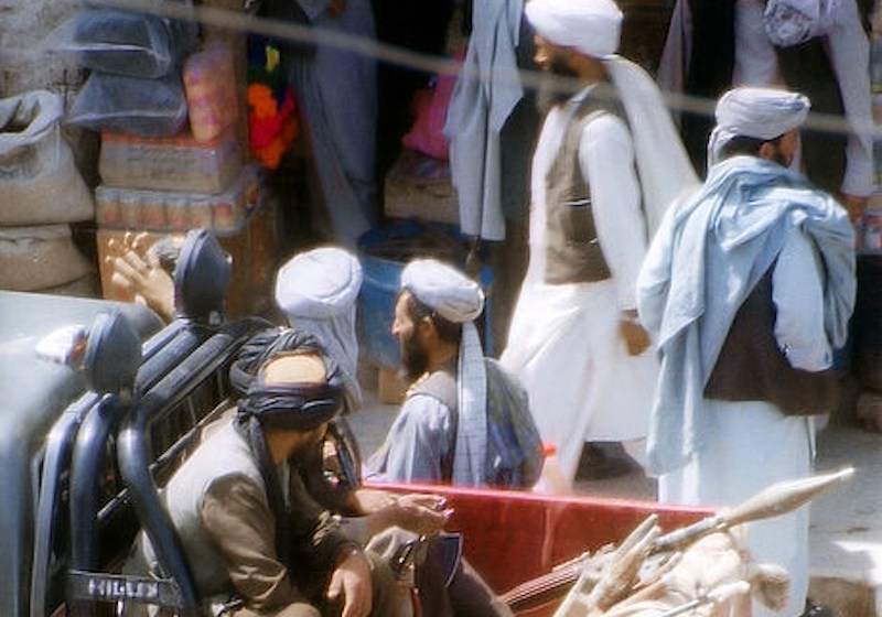 Taliban police in a pickup truck patrolling a street in Herat, Afghanistan