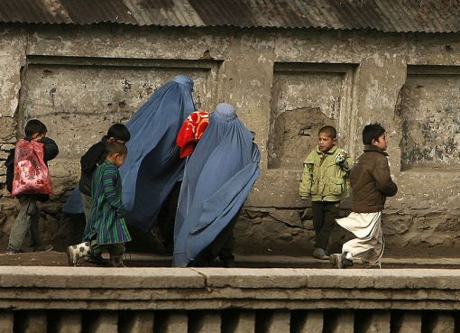 Women wearing burkas and their kids in Afghanistan