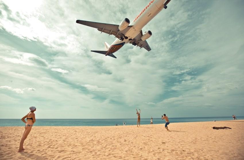 Aircraft landing above the beach in Phuket, Thailand