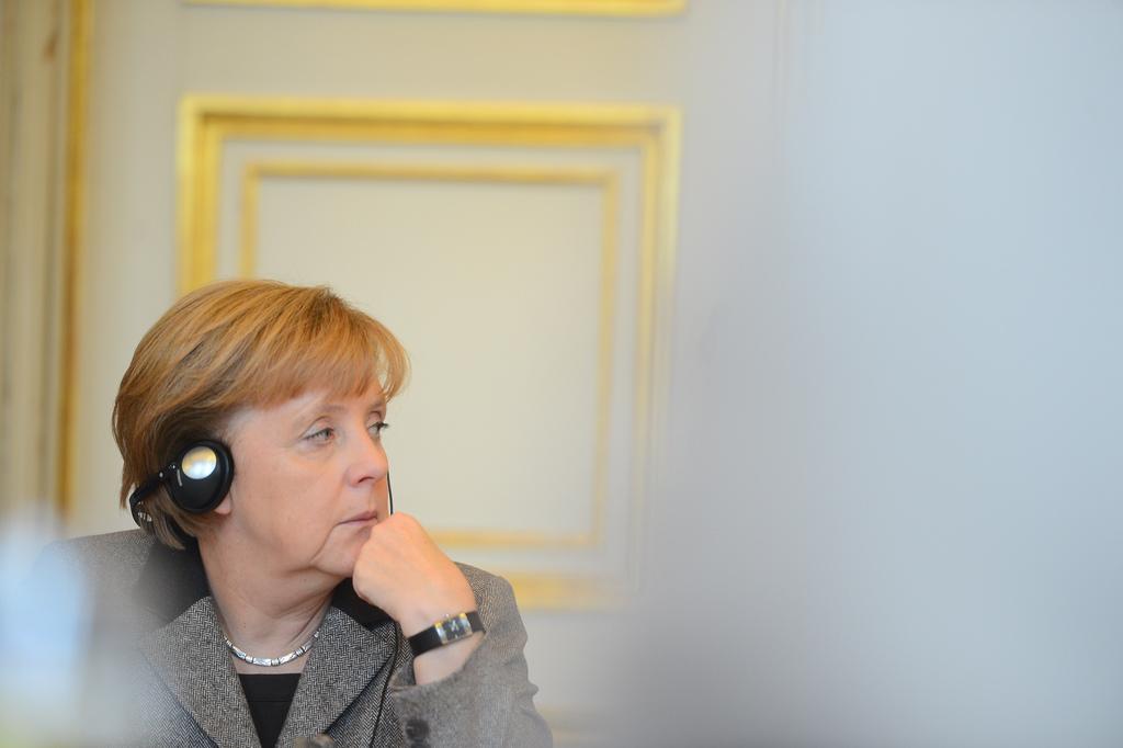 German chancellor Angela Merkel wearing headphones