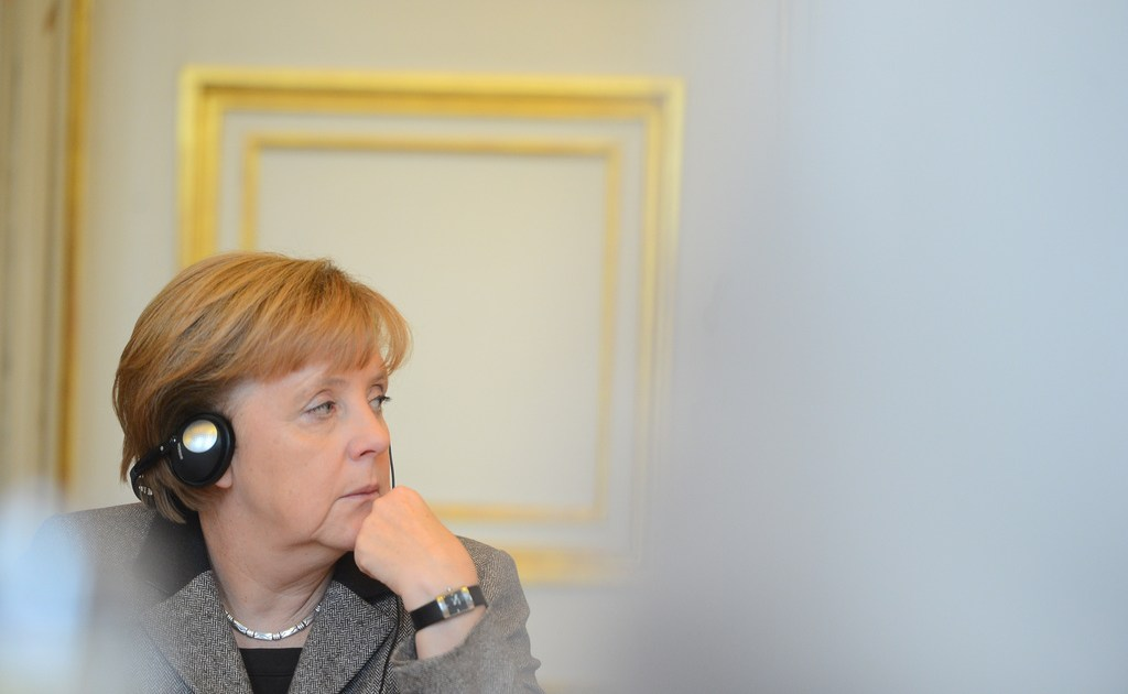 German chancellor Angela Merkel wearing headphones