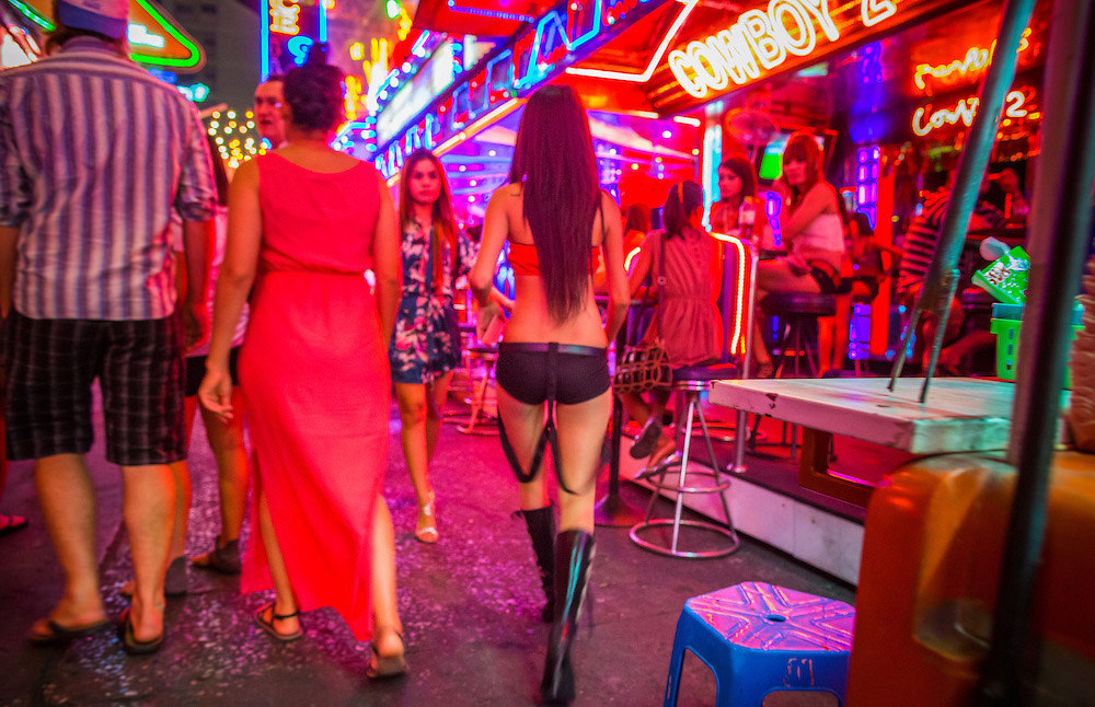 Bar girl walking on Soi Cowboy, Bangkok