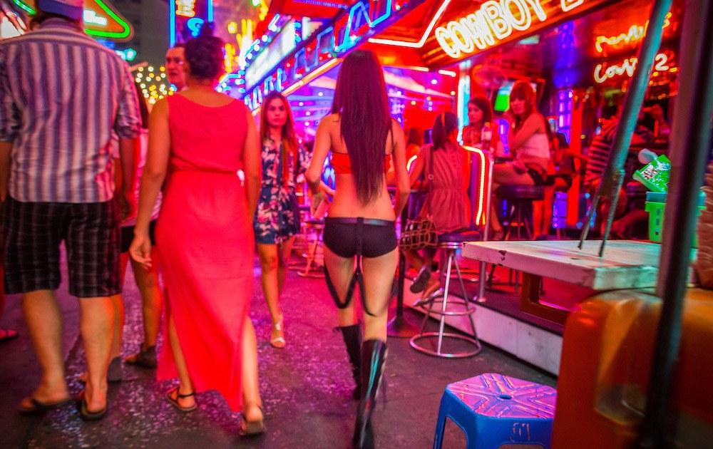 Bar girl walking on Soi Cowboy, Bangkok