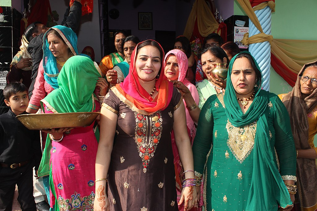 Hindu women attending Bhaat ceremony in India