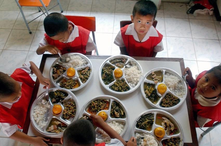 Children from a school in Korat eating
