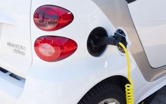 Electric car charging at EV charging station