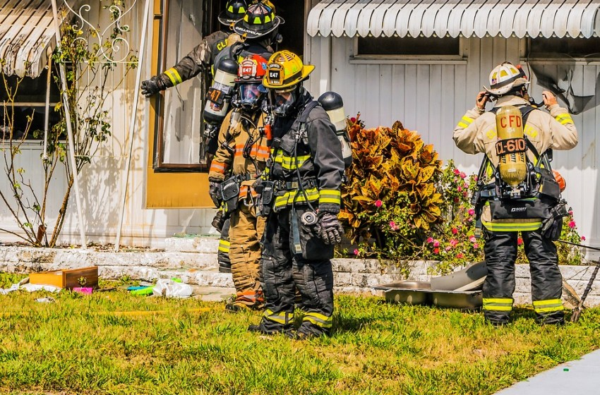 Firefighters after extinguish a fire in a house