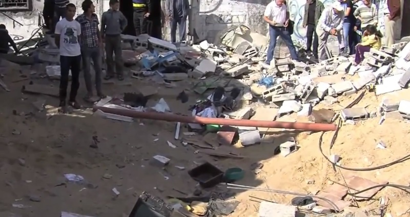 Thirteen Israeli soldiers, scores of Palestinians killed in deadly day of fighting in Gaza Strip