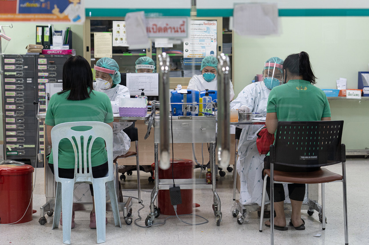 Thailand reports a new record number of COVID infections with 15,335 new cases
