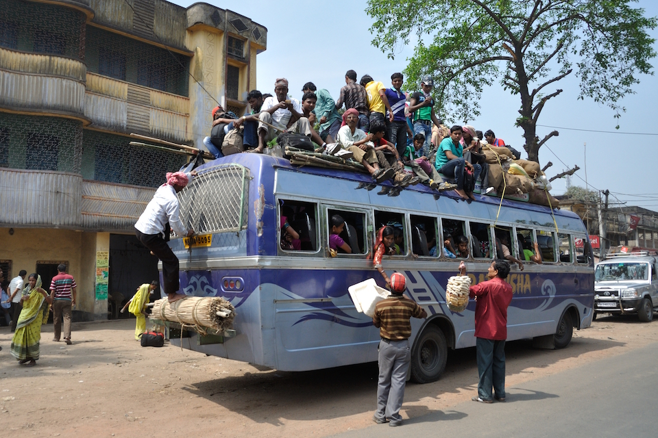 Bus with Passengers on the roof at Indian National Highway 34, Nakashipara-Nadia