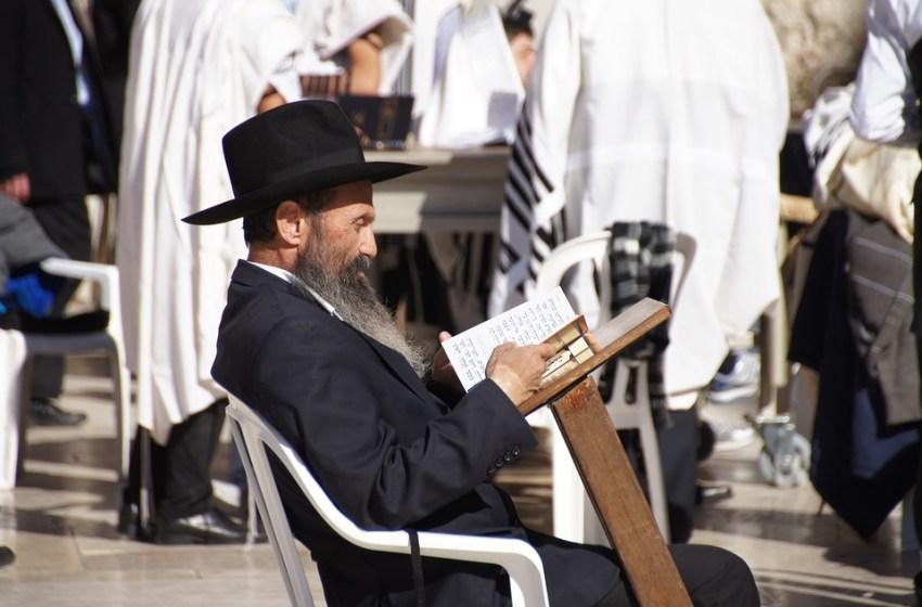 Rabbi reading the Torah in Jerusalem, Israel