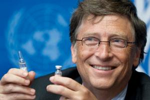 Bill Gates, Co-Chair the Bill & Melinda Gates Foundation shows a vaccine during the press conference