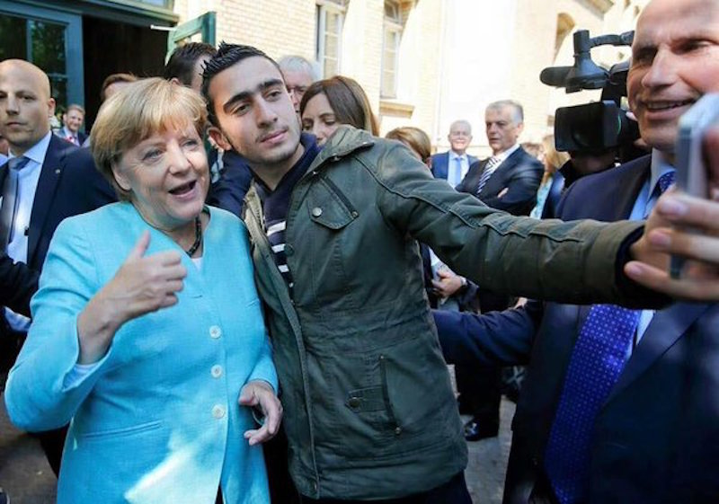 Angela Merkel selfie with Syrian refugee