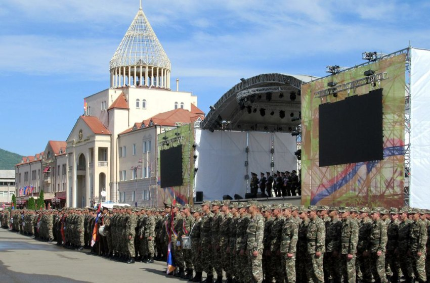 Nagorno Karabakh Defense Army troops assemble before the National Assembly building on Renaissance Square in Stepanakert, Republic of Artsakh